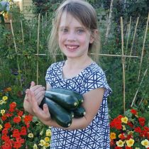 Poppy's Patch_Little Poppy with zucchini.jpg