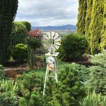 Gusti Orth_Windmill sculpture in garden.jpg