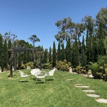 La Serre conifers surrounding lawn